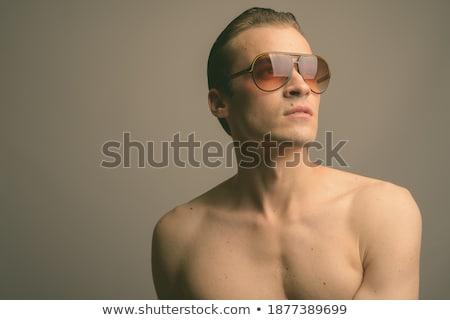 рубашки парень Солнцезащитные очки выстрел улыбаясь Сток-фото © stockyimages
