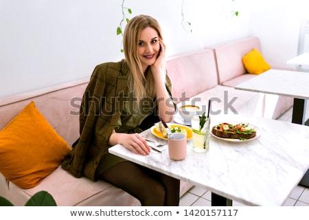 Beautiful blonde woman in fancy dress in luxury interior. Stock photo © Pilgrimego