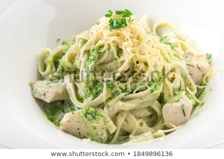 Tagliatelle pasta with pesto close up Stock photo © ozaiachin