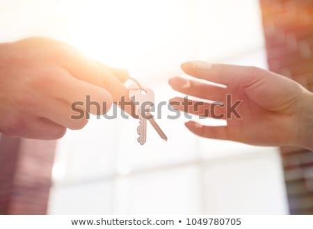 Ház kulcsok nő tart ki ezüst Stock fotó © REDPIXEL