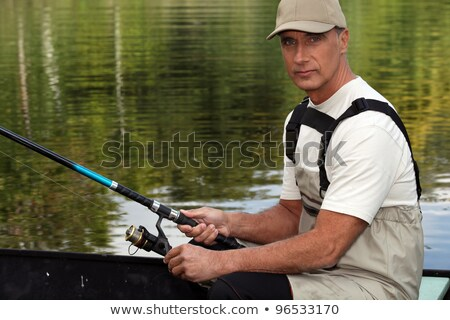 45 years old man on a boat and fishing Stock photo © photography33