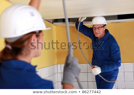A team of tradespeople installing plumbing Stock photo © photography33