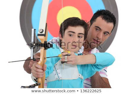 Fiú íjászat lecke fa sport diák Stock fotó © photography33