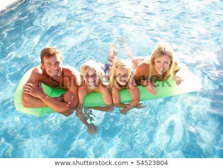 portret · glimlachend · man · ontspannen · zwembad · sport - stockfoto © wavebreak_media