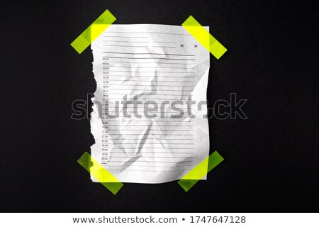 blank page with adhesive tape against a white background stock photo © wavebreak_media