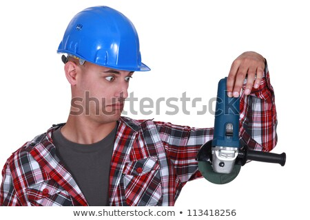 Uneasy tradesman looking at an angle grinder Stock photo © photography33