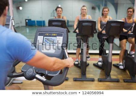 Happy woman teaches spinning class Stock photo © wavebreak_media