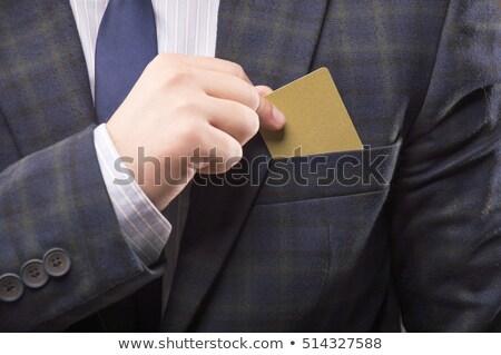Charismatic businessman showing his business card Stock photo © wavebreak_media