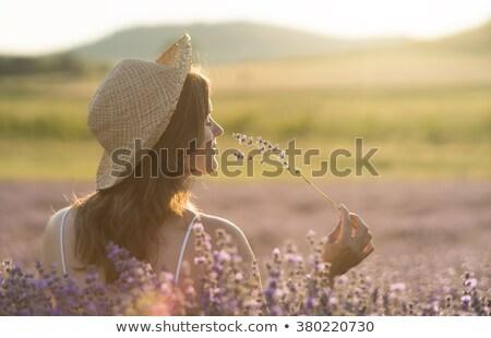 Cara pensativo mulher jovem flor pele Foto stock © HASLOO