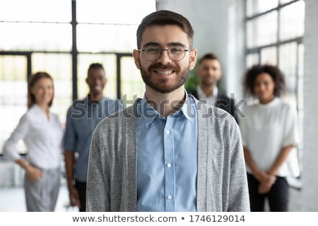business woman posing with smart associates behind stock photo © stockyimages