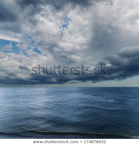 dramatic sky over darken sea rain before stock photo © mycola