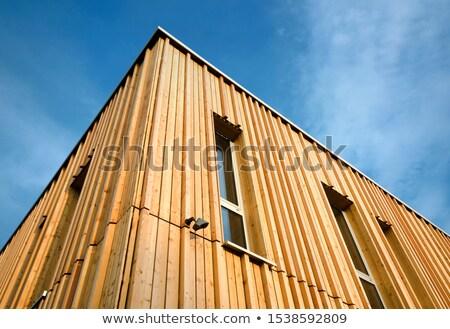 Drewna teleobiektyw widoku rząd malowany domów Zdjęcia stock © gophoto