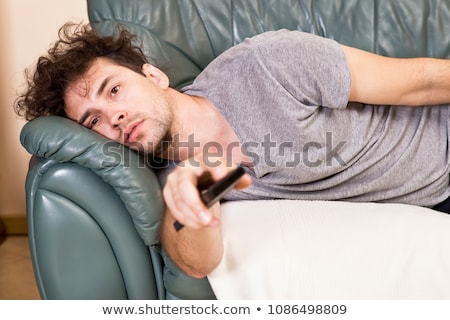young man, lying on the couch Stock photo © alexandrenunes