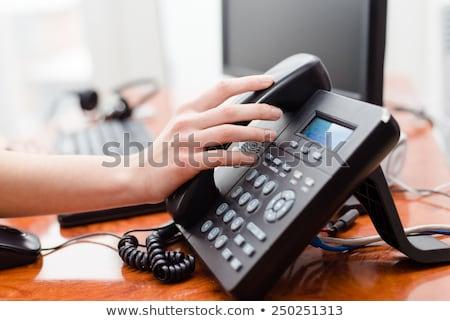 Girl pick up the phone call Stock photo © lewistse