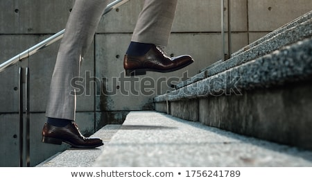 Young business man stepping forward  Stock photo © feedough
