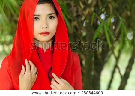 Pretty Vietnamese woman in a red head scarf Stock photo © smithore