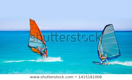wind surfers braving the winds stock photo © morrbyte