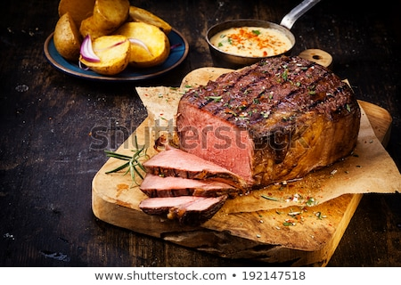 delicious grilled steak ready for serving stock photo © klinker