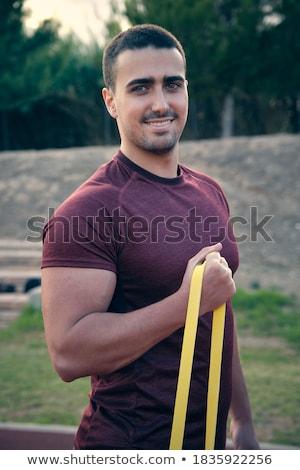Sin camisa muscular hombre resistencia banda gimnasio Foto stock © wavebreak_media