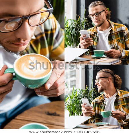 Composite image of smiling hipster holding notebook  Stock photo © wavebreak_media