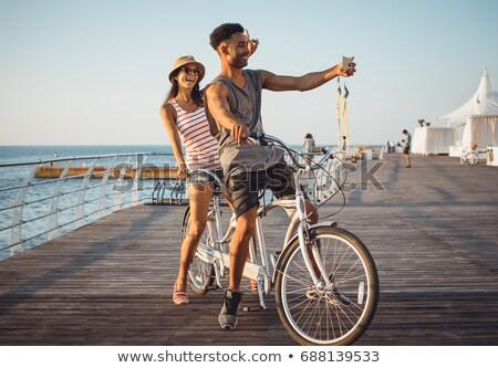 mutlu · çift · ayakta · tandem · bisiklet · portre - stok fotoğraf © deandrobot