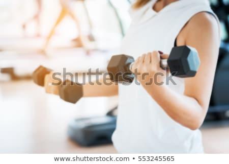 fitnessz · tornaterem · nő · erőedzés · emel · súlyok - stock fotó © restyler