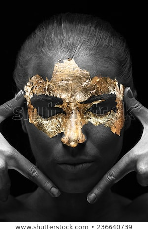 Beautiful girl with golden foil on face Stock photo © svetography