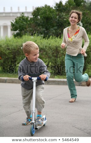 mother runs after the son on the bicycle stock photo © Paha_L