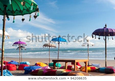 surfer · zonsondergang · bali · eiland · surfboard · lopen - stockfoto © artush