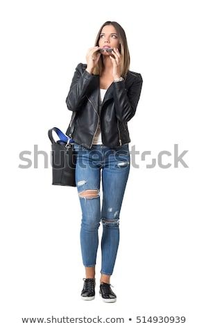 Pretty serious woman with handbag Stock photo © Aikon