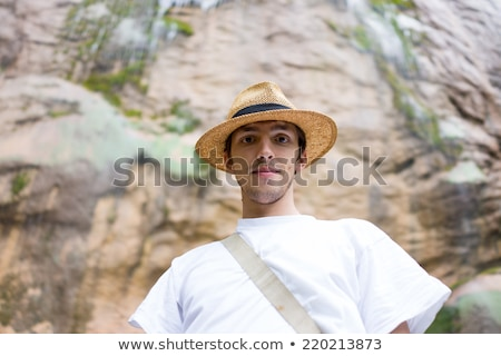 moço · naturalismo · parque · grande · cachoeira - foto stock © zurijeta