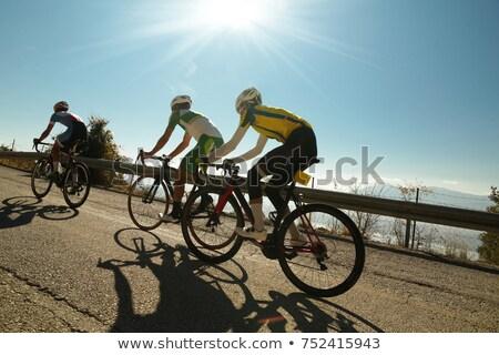 Homem equitação bicicleta alto montanhas pôr do sol Foto stock © photocreo