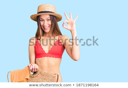 Smiling long haired beauty wearing bikini and hat Stock photo © dash