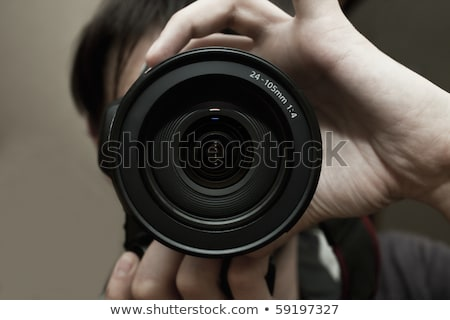 close up of male photographer with digital camera stock photo © dolgachov