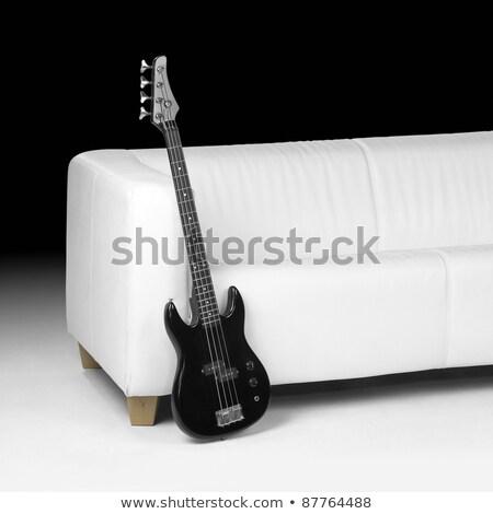 Basszus gitár dől kanapé kék elektromos Stock fotó © Kayco