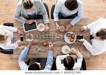 jovem · empresária · alimentação · escritório · computador - foto stock © stevanovicigor