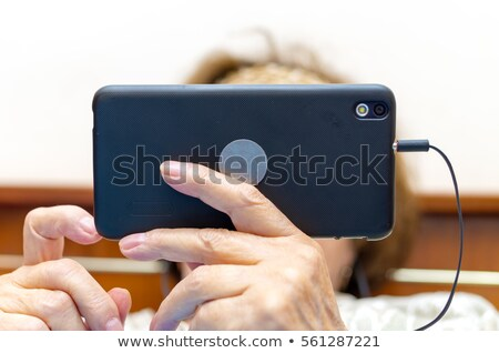 Man using smart phone in horizontal landscape orientation Stock photo © stevanovicigor