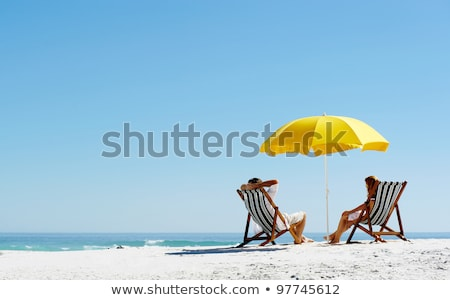 Summer holiday on the beach with people sunbathing Stock photo © bluering