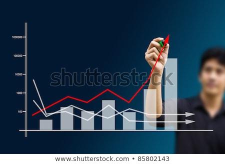 Businesswoman drawing with red marker felt tip pen Stock photo © stevanovicigor