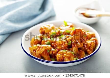 Baked cauliflower brown plate stock photo © TasiPas