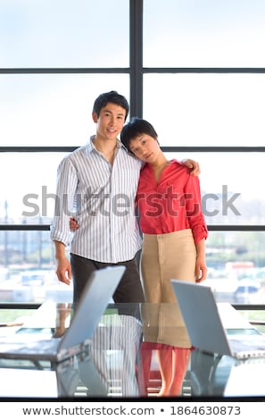 Vertical image of man embraces the laptop Stock photo © deandrobot