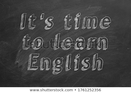 time to learn handwritten by white chalk on a blackboard stock photo © tashatuvango