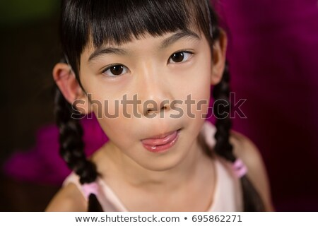 Girl making funny faces during birthday party at home Stock photo © wavebreak_media