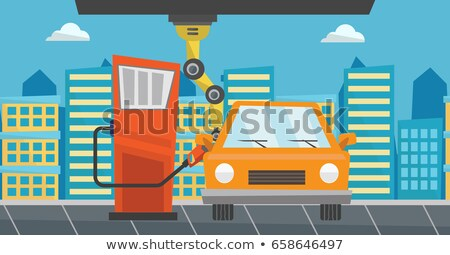 Robot filling up fuel into car at the gas station. Stock photo © RAStudio
