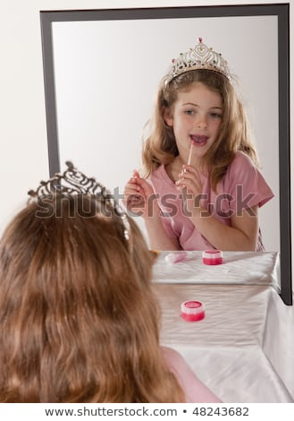 Young girl with tiara on, daydreaming Stock photo © IS2
