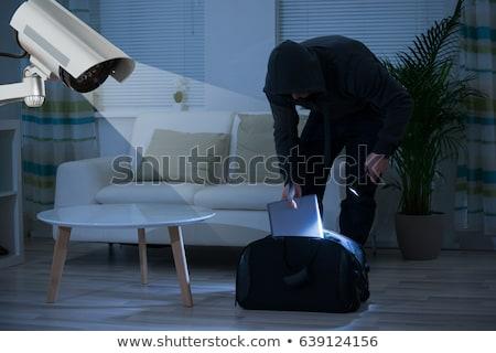 scassinatore · laptop · indossare · maschera · bianco - foto d'archivio © andreypopov