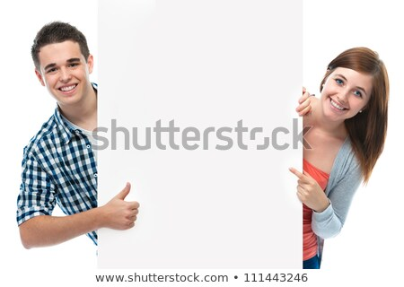 Image of two joyful women smiling and holding empty placard abov Stock photo © deandrobot