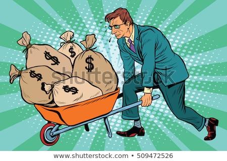 Işadamı itme el arabası tok dolar para Stok fotoğraf © Elnur
