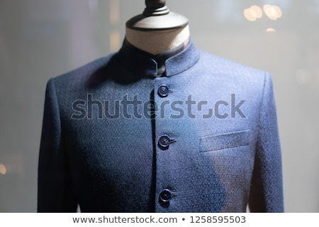 Man in fitting of a bespoke shirt in studio of tailor Stock photo © Kzenon