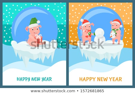 Happy New Year Piglets Building Snowman from Snow Stock photo © robuart